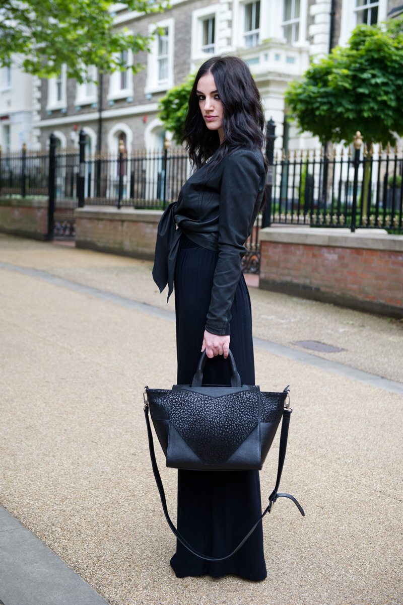 Fashion Blogger Stephanie of FAIIINT wearing Barneys Originals draped leather jacket tied up, ASOS maxi dress, Bracher Emden Classic structured tote, AllSaints silver choker necklace. All black outfit, gothic, street style.