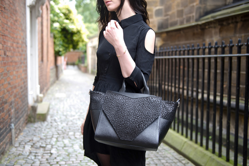Fashion blogger Stephanie of FAIIINT wearing ASOS cold shoulder shirt dress, Bracher Emden Classic structured tote, Rick Owens wedges, ASOS spiked bangle. All black outfit, goth, street style.