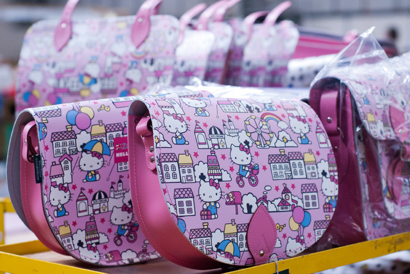 FAIIINT Zatchels factory shop opening Leicester, pink Hello Kitty satchel bags lined up in the factory