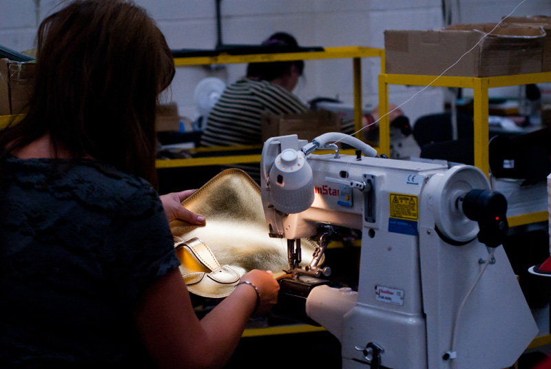 FAIIINT Zatchels factory shop opening Leicester, Leather sewing machinist stitching metallic gold satchel bag at the factory