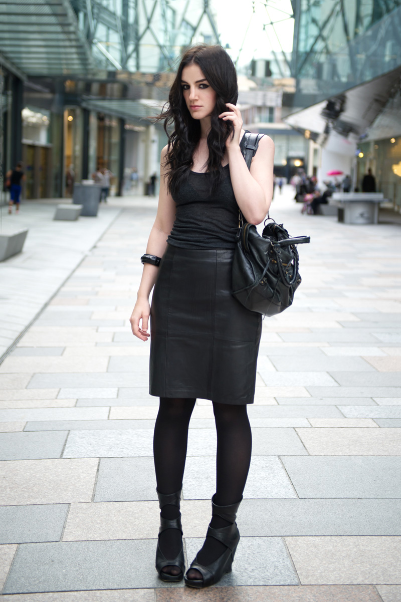Fashion blogger Stephanie of FAIIINT wearing Reiss black leather Ezra skirt, Topshop charcoal grey tank top, Rick Owens wedges, ASOS studded bangle, Balenciaga city bag. All black outfit, dark style, texture mix, street style.