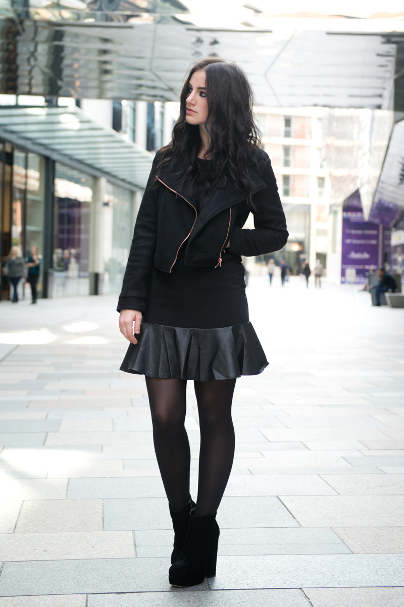 Fashion blogger Stephanie of FAIIINT wearing Minkpink wool biker jacket, Little Mistress faux leather frill dress, Stylistpick velvet boots. All black, street style, goth.