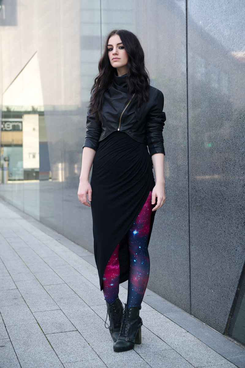 fashion blogger Stephanie of FAIIINT wearing handmade black cropped & draped leather jacket, River Island asymmetric skirt, Choies pink galaxy space print leggings, Topshop boutique lace up boots. Street style, sci fi, gothic.