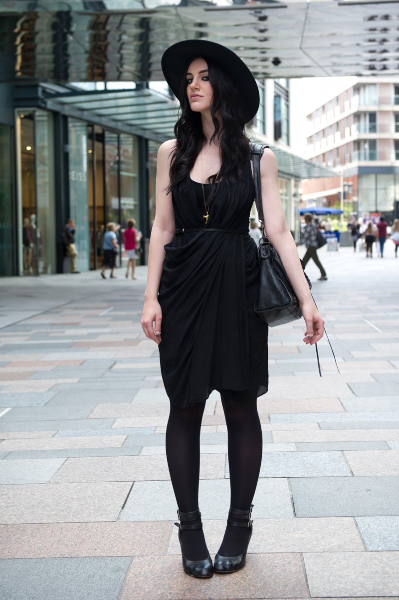 Fashion blogger Stephanie of FAIIINT wearing Catarzi fedora, Allsaints draped silk dress, Vivienne Westwood animal toe shoes, Balenciaga city bag. All black, dark style, gothic outfit, street style