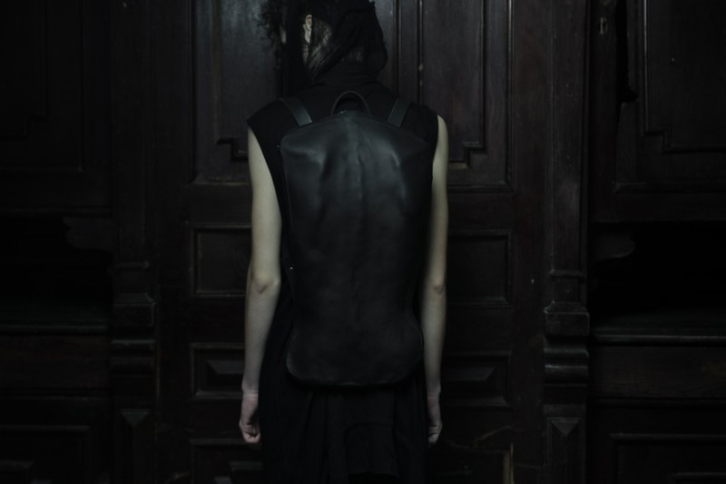 Konstantin Kofta 'Hug' collection black leather scoliosis backpack bag twisted spine human anatomy. Dark style, gothic, indepenent designer, lookbook