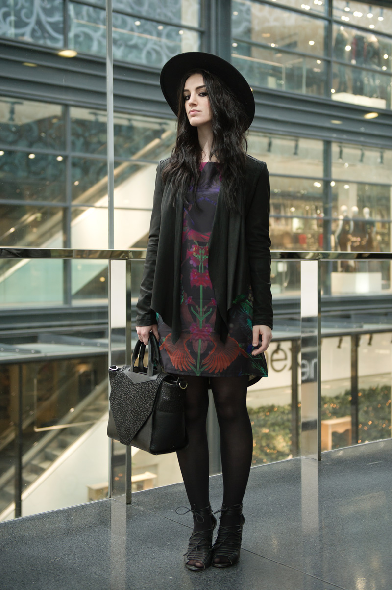 Fashion blogger Stephanie of FAIIINT wearing Barneys Originals drape leather jacket, Yumi midnight menagerie bird & floral print dress, Bracher Emden classic tote bag, Skin by Finsk lace up wedges, Catarzi fedora, all black outfit, gothic, street style.