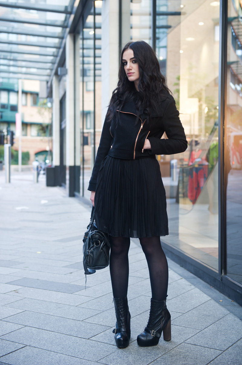 Fashion blogger Stephanie of FAIIINT wearing minkpink wool biker jacket, Pussycat London pleated shirt dress, Topshop lace up boots, Balenciaga city bag. All black outfit, street style.