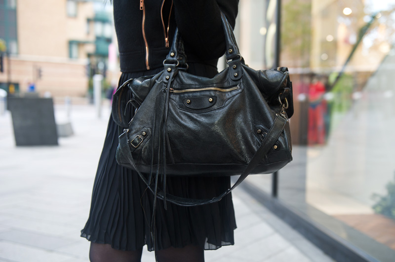 Fashion blogger Stephanie of FAIIINT wearing minkpink wool biker jacket, Pussycat London pleated shirt dress, Balenciaga city bag. All black outfit, street style.