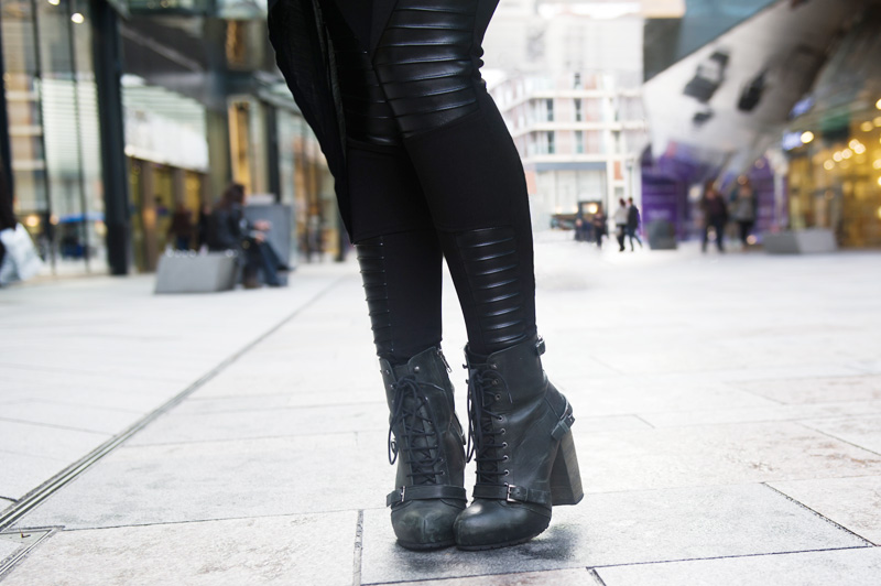 Fashion blogger Stephanie of FAIIINT wearing Topshop asymmetric vest, Evil Twin zero paneled leggings, Topshop lace up boots. Sci Fi, alien, superhero, all black.