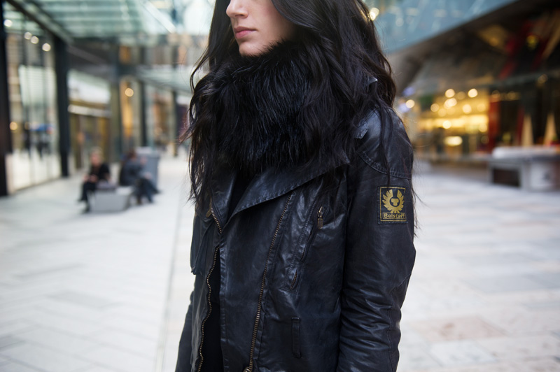 Fashion blogger Stephanie of FAIIINT wearing Belstaff Sammy Miller Waxed Biker Jacket, Faux Fur snood scarf. All Black.