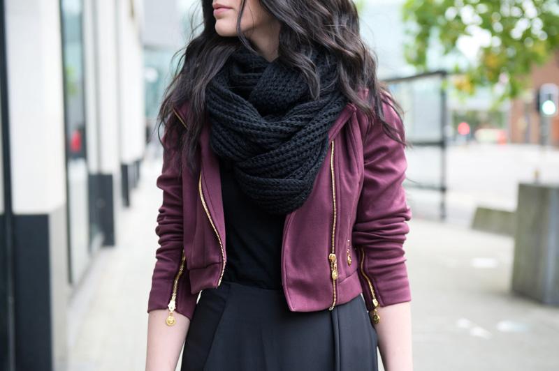 Fashion blogger Stephanie of FAIIINT wearing Yumi burgundy oxblood biker jacket, ASOS black chunky knit snood, maxi skirt.