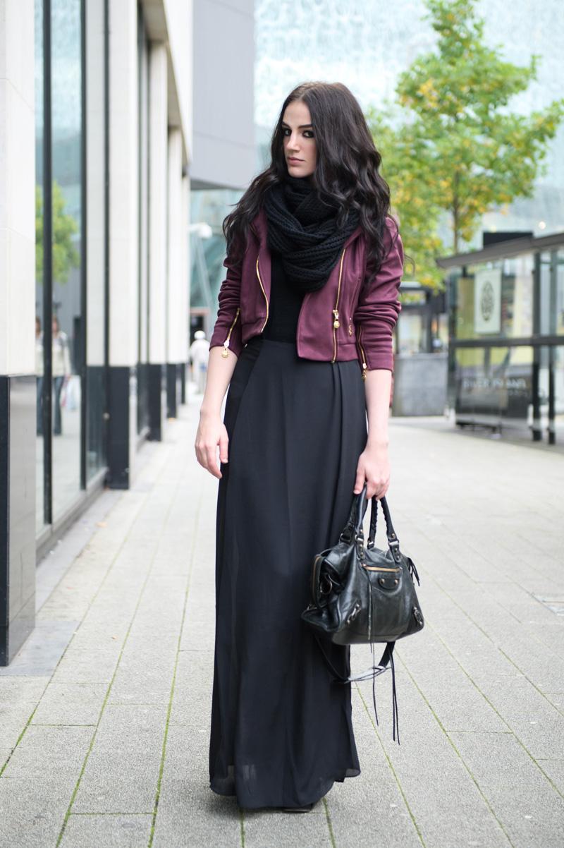 Fashion blogger Stephanie of FAIIINT wearing Yumi burgundy oxblood biker jacket, ASOS black chunky knit snood, maxi skirt & balenciaga city bag.