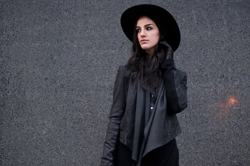fashion blogger Stephanie of FAIIINT wearing Catarzi fedora, Barneys Originals draped leather jacket, Chiara fashion denim shirt, River Island asymmetric skirt, Rick Owens wedges, Balenciaga city. Dark fashion, all black outfit, tailored, androgynous.