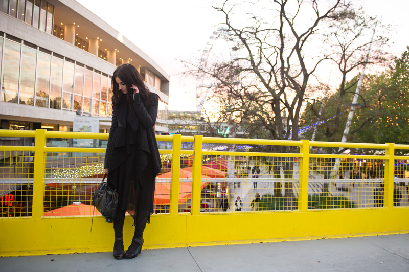 Fashion blogger Stephanie of FAIIINT wearing Todd Lynn for Topshop Cropped Tux Jacket with fur collar, ASOS waterfall draped cardigan, Warehouse chiffon dress, Rick Owens Wedges, Balenciaga City Bag. All black outfit, london, tourist, eye, dark style, goth outfit.