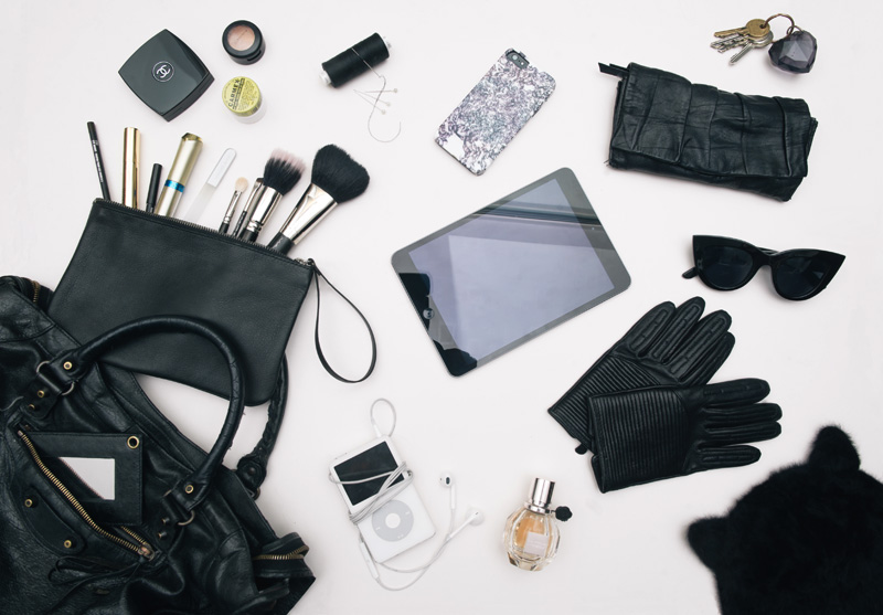 Fashion blogger Stephanie of FAIIINT what's in my Balenciaga city bag. Makeup, flowerbomb perfume, iPad mini, iPod, iPhone 5, Leather gloves, Next cat ear hat, ASOS Cat eye sunglesses, MAC Makeup brushes, Pieces leather pouch.