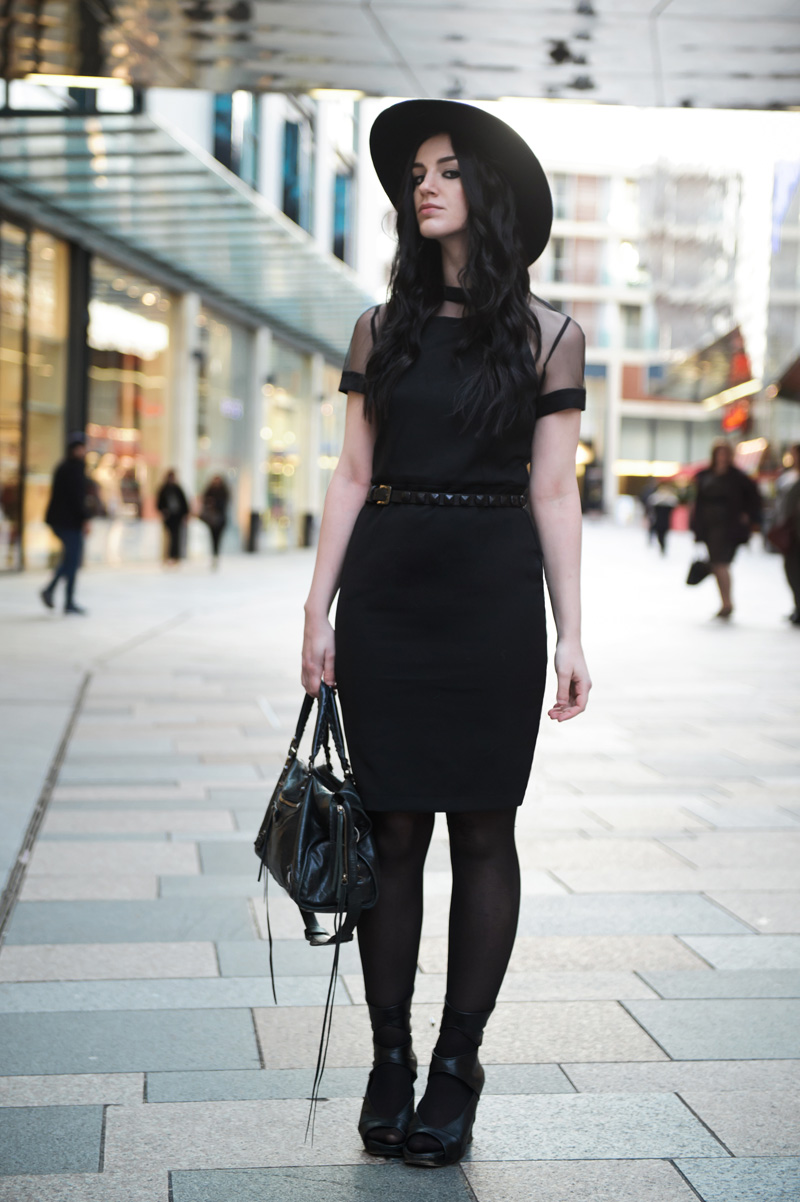 Fashion blogger Stephanie of FAIIINT wearing Catarzi fedora, Paper Dolls mesh panel dress, Topshop studded belt, Rick Owens wedges, Balenciaga city bag. All black outfit, gothic street style.