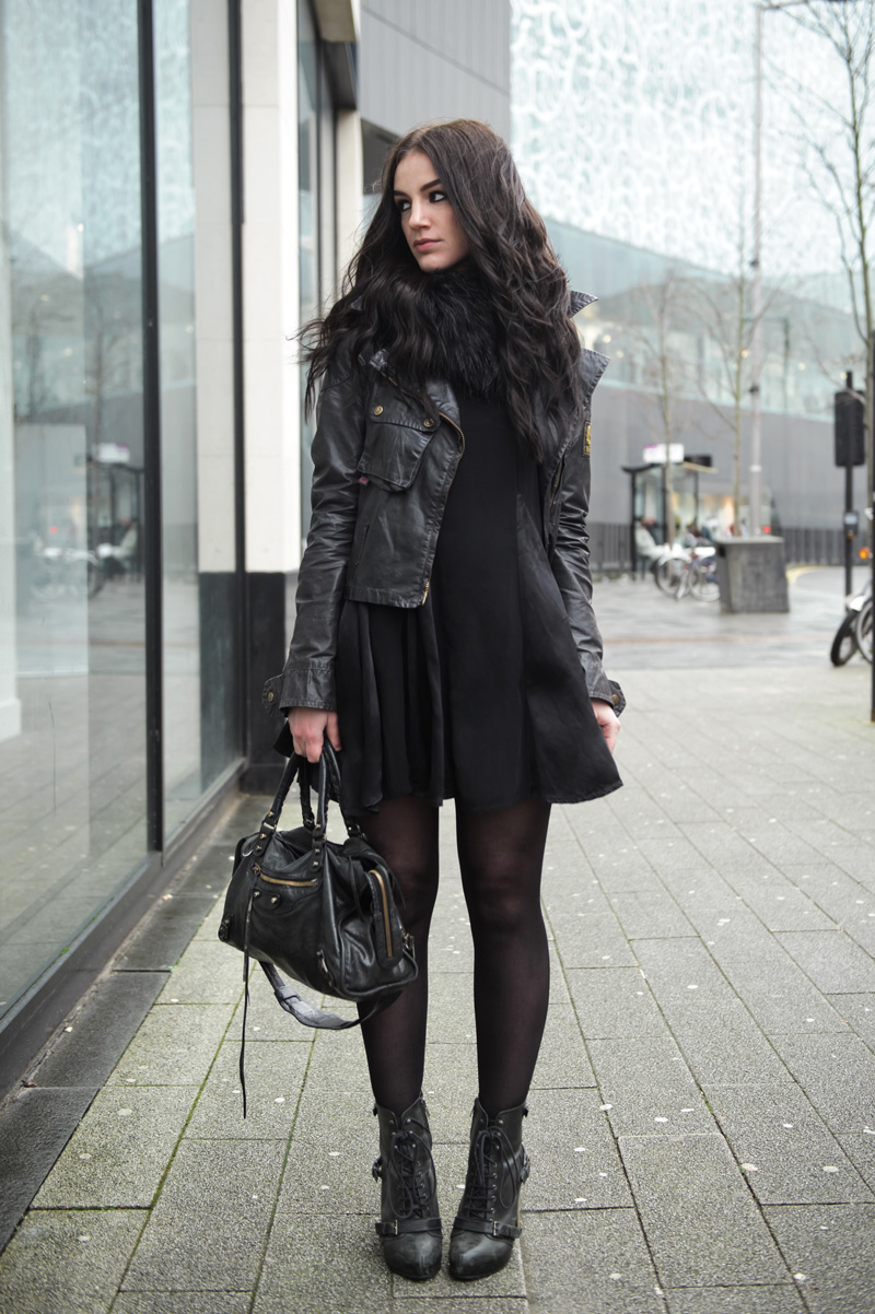 Fashion blogger Stephanie of FAIIINT wearing Belstaff waxed cotton sammy miller jacket, faux fur snood, This Is A Love Song ( TIALS ) pom pom cheerleader dress, Topshop Boots, Balenciaga city