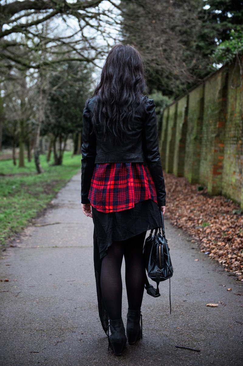 Fashion blogger Stephanie of FAIIINT wearing black Barneys Originals draped leather jacket, Lookbook store red tartan plaid shirt, OASAP asymmetric chiffon dress, Kurt Geiger wedge boots, Balenciaga city. Gothic grunge outfit.