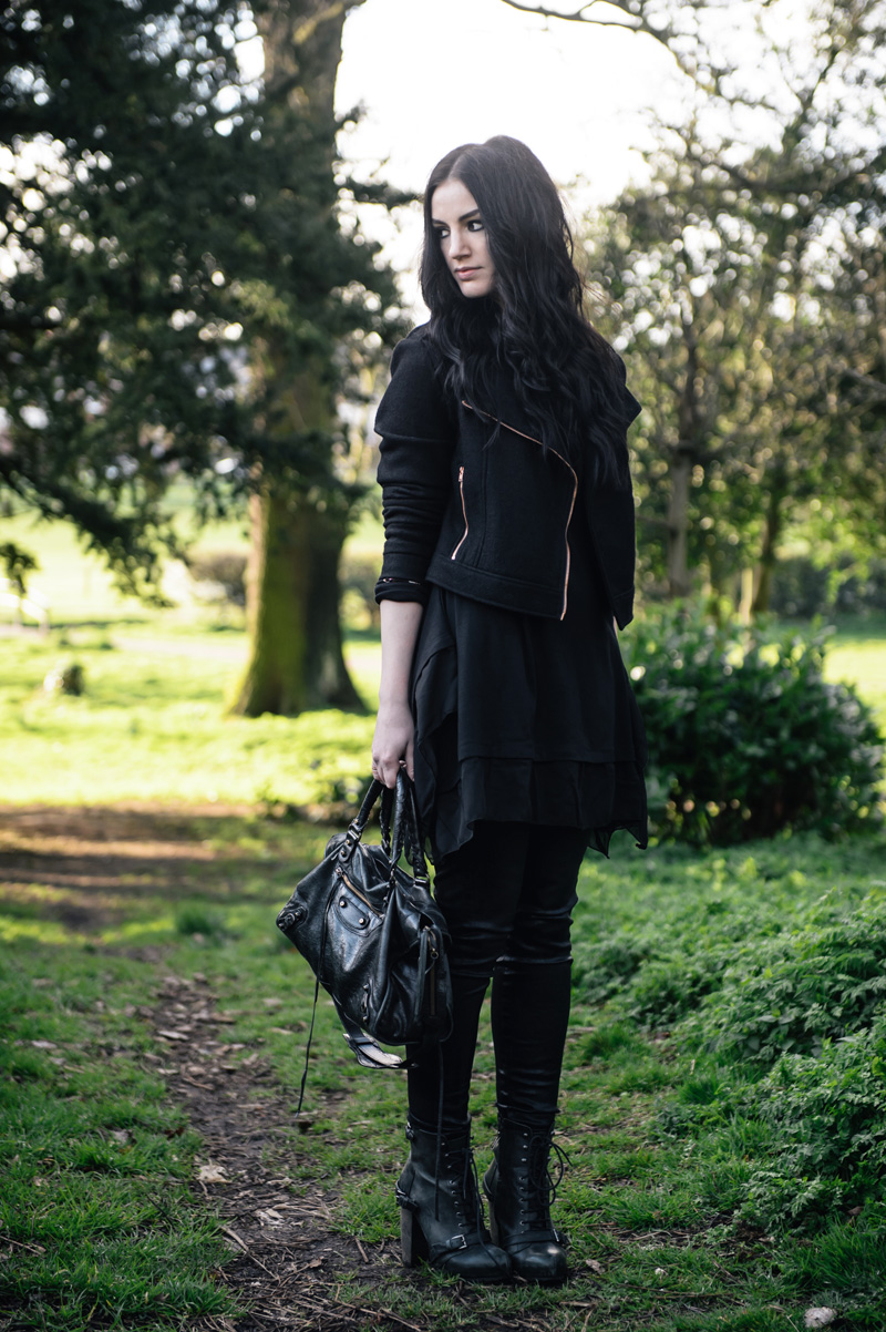 Fashion Blogger Stephanie of FAIIINT wearing all black outfit MinkPink wool biker jacket, Sammy Dress Tunic, Topshop Unique coated jeans, Topshop Boutique lace up boots, Balenciaga City bag, Next rose gold rings.