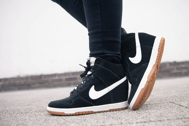 Fashion blogger Stephanie of FAIIINT wearing Nike sky hi high dunk sneakers black suede & white leather