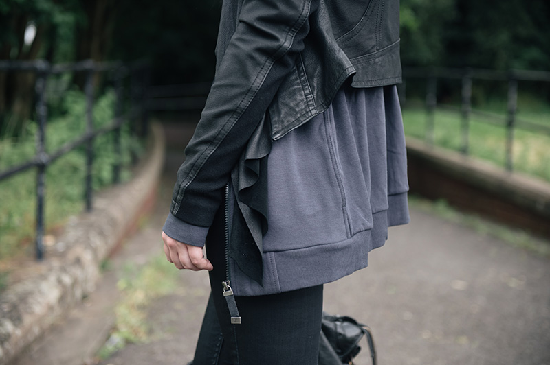 Fashion blogger Stephanie of FAIIINT wearing Barneys originals draped leather jacket, OnePiece charcoal stroll hoodie, Helmut Lang tee, Topshop coated jeans.