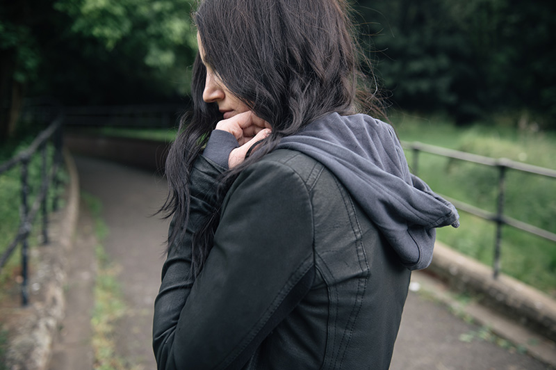 Fashion blogger Stephanie of FAIIINT wearing Barneys originals draped leather jacket, OnePiece charcoal stroll hoodie. All black off duty casual street style outfit.