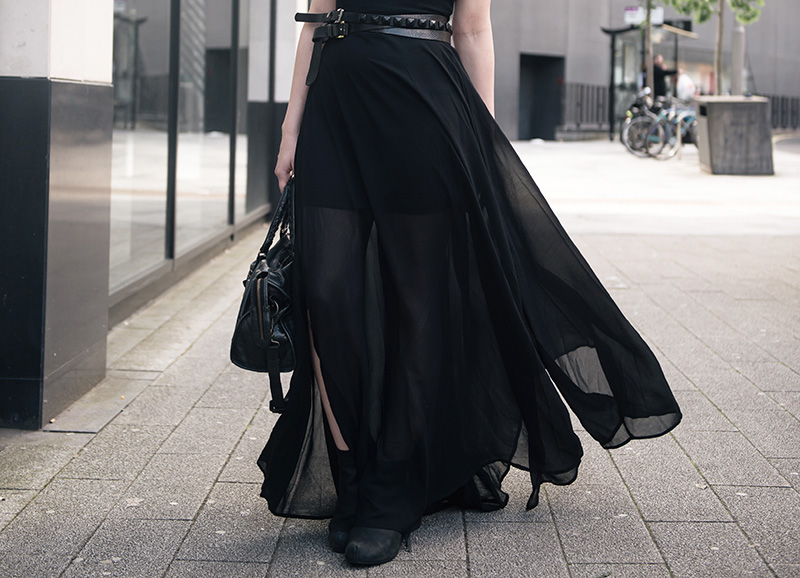 Fashion blogger Stephanie of FAIIINT wearing Choies black chiffon maxi dress,  ASOS & Topshop studded wrap belt, Kurt Geiger boots, Balenciaga city. All black summer goth street style outfit.