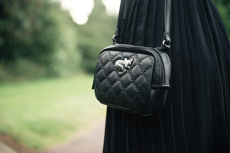FAIIINT wearin Nica black quilted cross body Pheobe bag with silver sleeping fox hardware