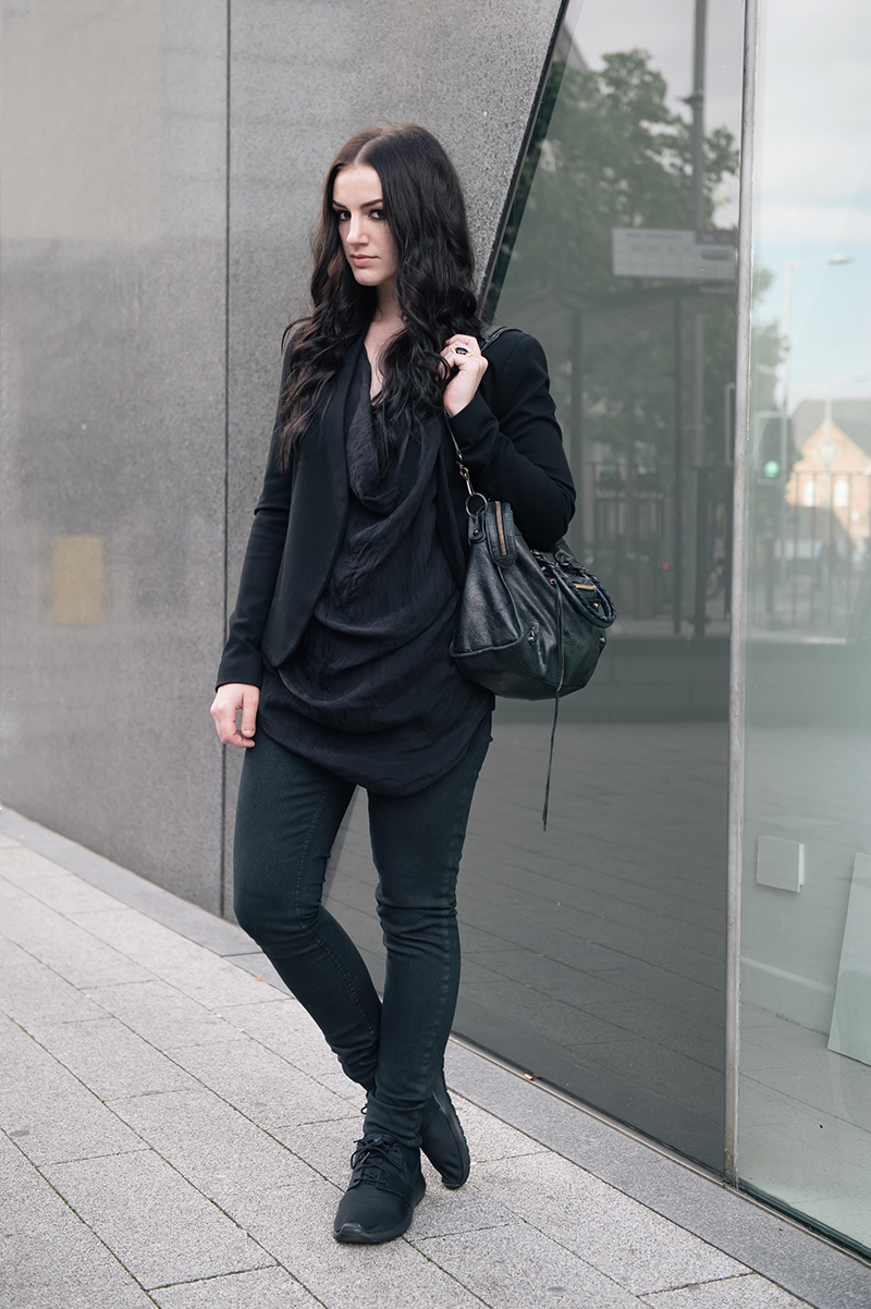 Fashion blogger Stephanie of FAIIINT wearing Topshop slim blazer & snake print skinny jeans, FOX draped silk cowl tank top, Kasun London vampire bite ring, Nike Roche Run monochrome black trainers, Balenciaga city. All black smart casual street style outfit.