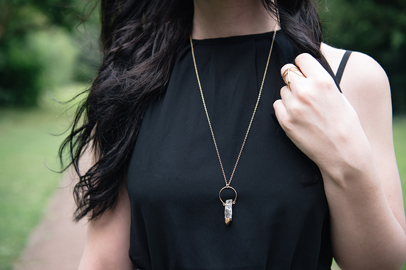 FAIIINT Abaday black dress, Younghearts gold dipped clear quartz crystal necklace, RockLove sacred geometry arrow ring