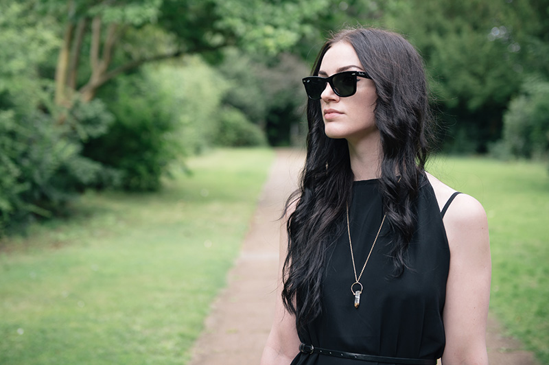 Fashion blogger Stephanie of FAIIINT wearing Abaday chiffon dress, Ray Ban Wayfarer sunglasses, Younghearts quartz crystal necklace. All black, dark fashion gothic summer street style outfit
