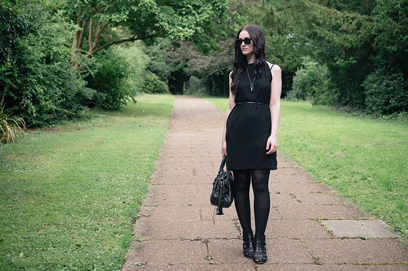 Fashion blogger Stephanie of FAIIINT wearing Abaday chiffon dress, Ray Ban Wayfarer sunglasses, Younghearts quartz crystal necklace, Kurt Geiger buckled wedges, Balenciaga city bag. All black, dark fashion gothic summer street style outfit