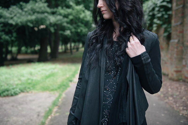 Fashion blogger Stephanie of FAIIINT wearing Barneys Originals draped leather jacket, ASOS cardigan, Yumi constellation print dress, RockLove gold arrow ring.