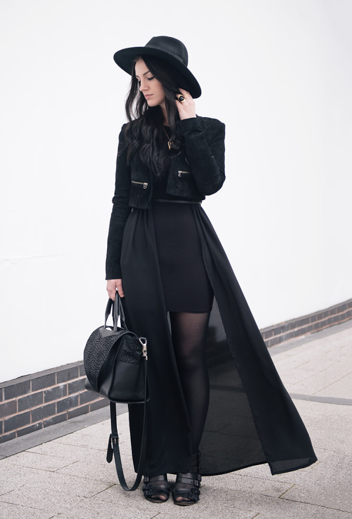 Fashion blogger Stephanie of FAIIINT wearing Catarzi fedora, Topshop laser cut cropped suede jacket, ASOS dress, BooHoo maxi chiffon kimono, Rocklove sacred geometry arrow ring & gold chevron necklace, Kasun London vampire bite ring, Kurt Geiger buckled wedges. All black goth witch street style outfit.