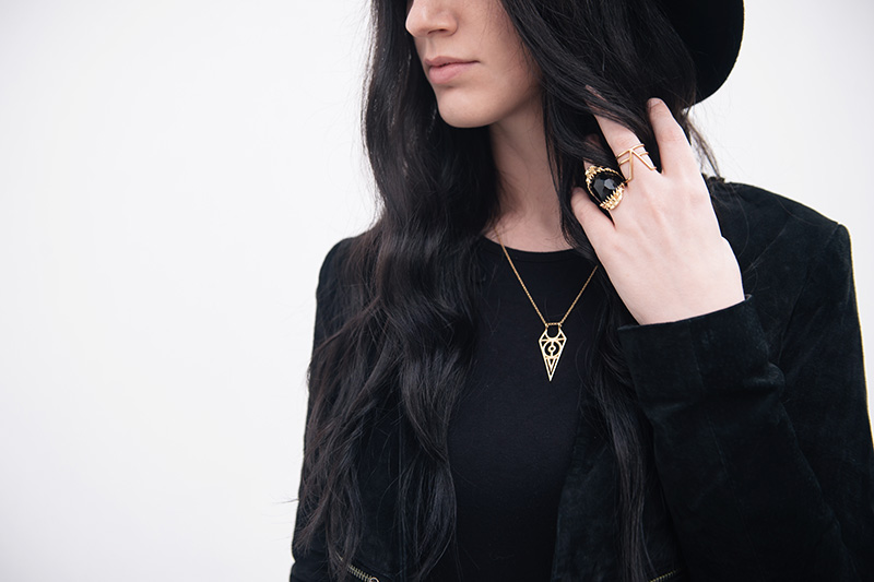 Fashion blogger Stephanie of FAIIINT wearing Topshop laser cut cropped suede jacket, Rocklove sacred geometry arrow ring & gold chevron necklace, Kasun London vampire bite ring. Outfit Details.