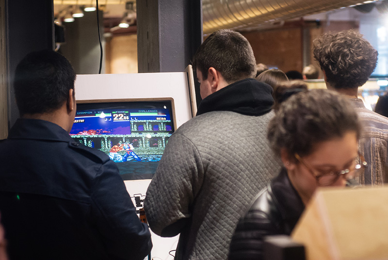 Urban Outfitters Leicester Store Launch guys playing arcade video games street fighter