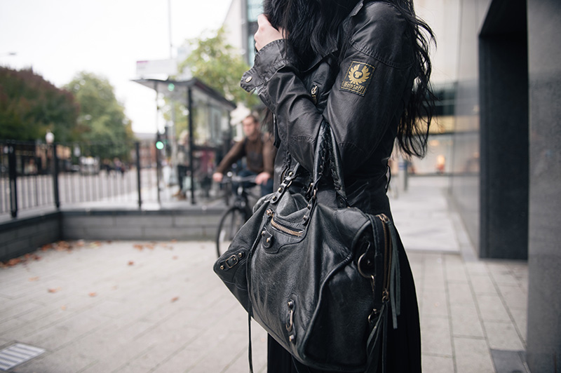 Fashion blogger Stephanie of FAIIINT wearing Balenciaga city bag, Belstaff Sammy Miller waxed jacket. All black street style outfit details.
