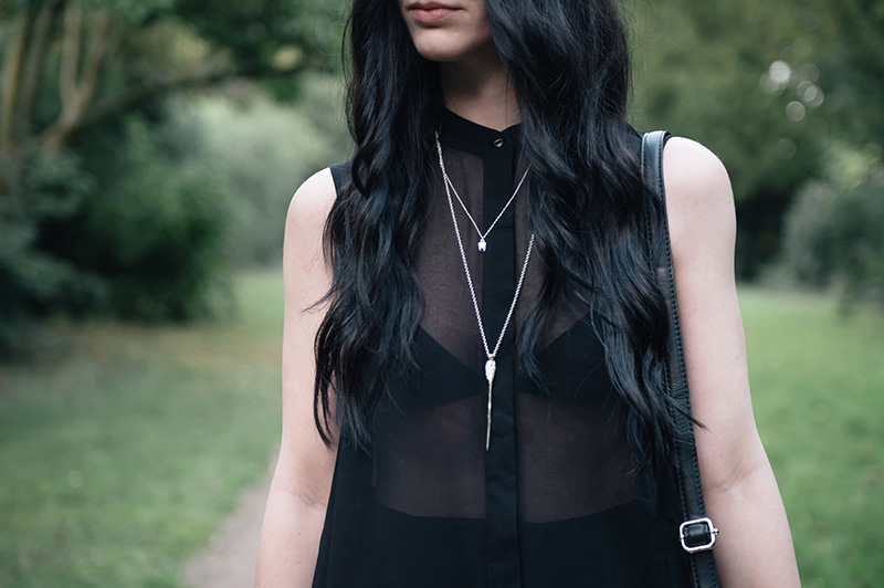 Fashion blogger Stephanie of FAIIINT wearing H&M chiffon asymmetric shirt, triangle basic bra, Bloody Mary Metal silver lovehunter's arrow & tiny tooth necklace. All black summer dark street style outfit details