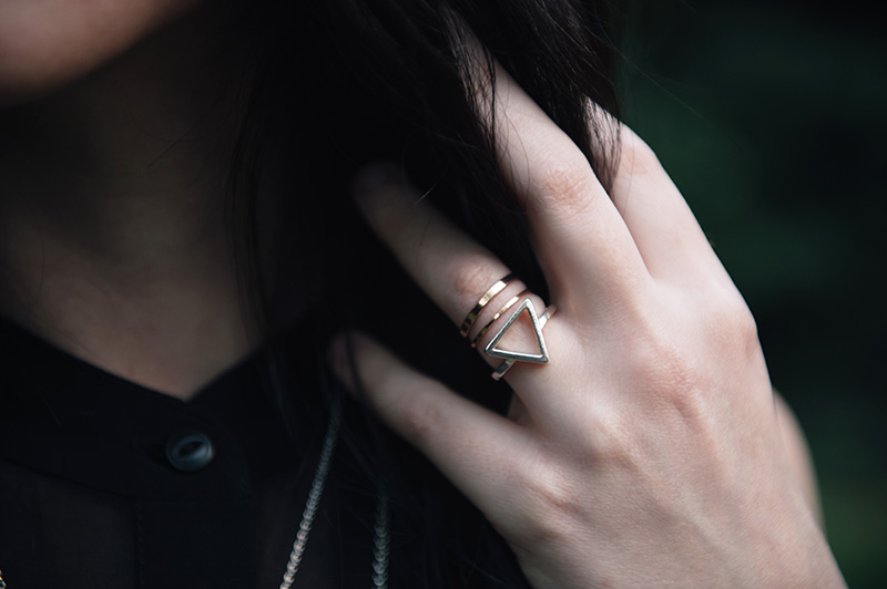 Fashion blogger Stephanie of FAIIINT wearing Bloody Mary Metal fire alchemy silver ring & copper stacked bands