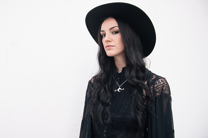 Fashion blogger Stephanie Brown of FAIIINT wearing Catarzi fedora, Pins & Needles at Urban Outfitters lace kimono, AllSaints Shirt, Bloody Mary Metal Luna Tribe Luna Love necklace. Dark street style, all black witchy outfit.