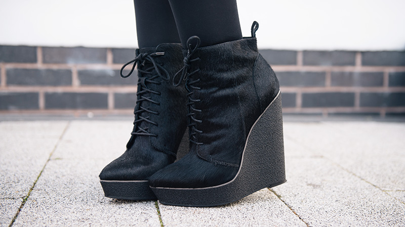 Fashion blogger Stephanie Brown of FAIIINT wearing Kurt Geiger ponyhair 'Solar' platform wedge ankle boots