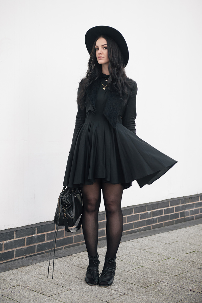 Fashion blogger Stephanie of FAIIINT wearing Todd Lynn x Topshop cropped tux jacket, H&M shirt dress, Phoebe Jewellery moonstone moon & little bat gold necklace, Skin by Finsk laced wedges, Balenciaga city bag, Catarzi fedora. All black witchy street style outfit.