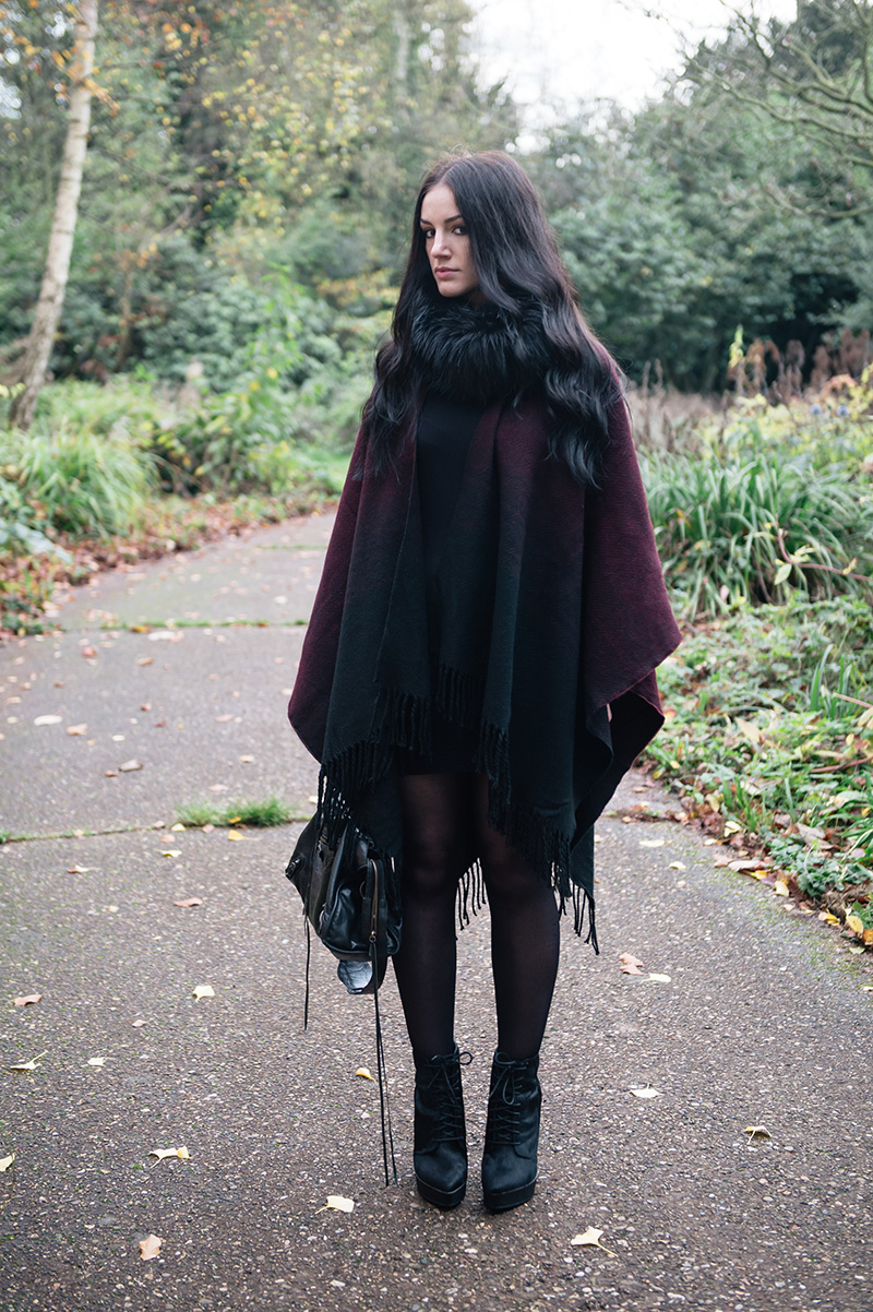 Fashion blogger Stephanie of FAIIINT wearing Yumi black & oxblood ombre blanket cape poncho, Phoebe Jewellery double moonstone moon & star and star stacking rings, FAIIINT faux fur snood, Kurt Geiger ponyhair ankle boots, Balenciaga city. Cosy Autumn street style outfit.