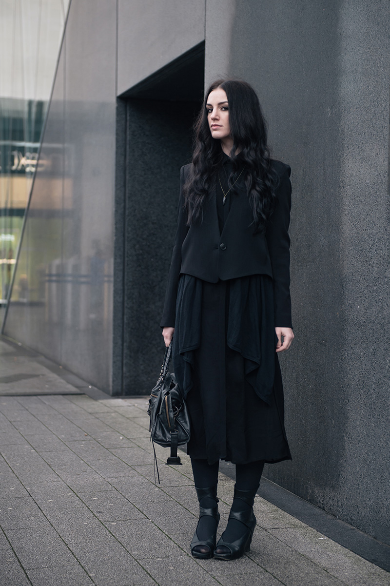 Fashion blogger Stephanie of FAIIINT wearing Theyskens' Theory Cropped Jacket, Mango draped cardigan, Isabel De Pedro printed shirt dress, BVRNT wooden necklace, Rick Owens Wedges, Balenciaga city bag. All black everything street style.