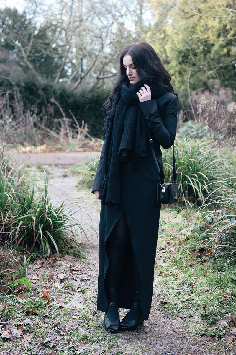 Fashion blogger Stephanie of FAIIINT wearing ASOS oversized scarf, Todd Lynn x Topshop Tux Jacket, State of Being cross over maxi skirt, Nica Venice small crossbody bag, Phoebe Jewellery moonstone moon & star double ring, Rick Owens wedge sandals. All black street style gothic draped outfit.