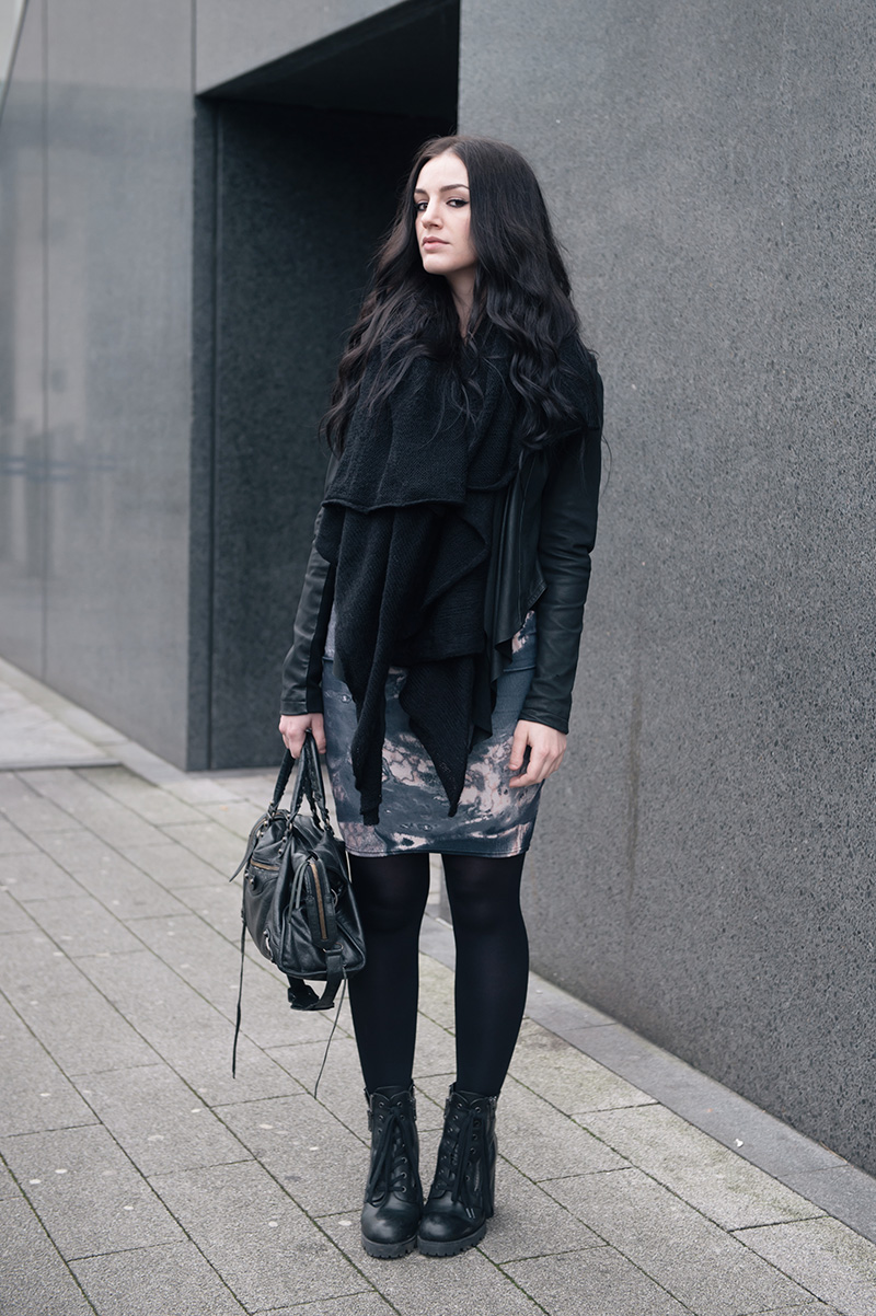 Fashion blogger Stephanie of FAIIINT wearing ASOS scarf, Barneys Original's draped leather jacket, Daisy Street oil spill printed dress, Ash Poker lace up boots, Balenciaga city bag. All black gothic casual street style outfit.