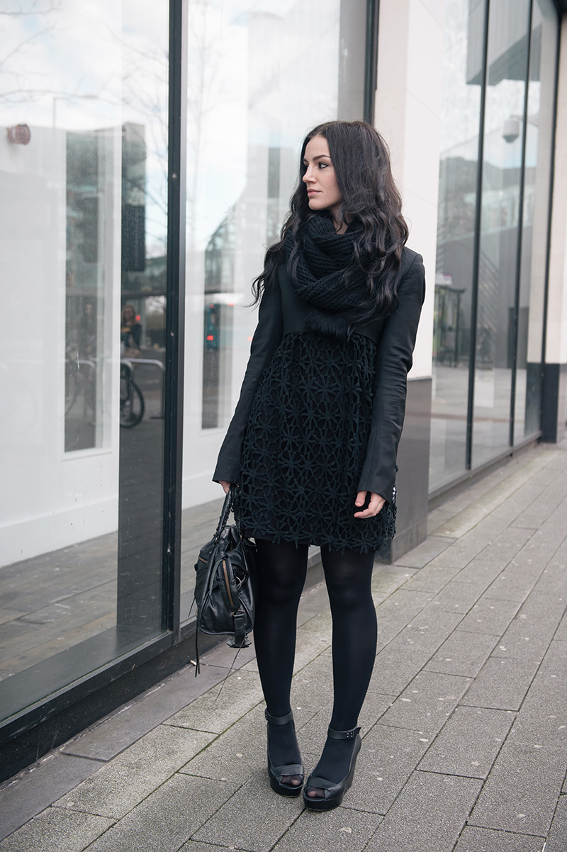 Fashion blogger Stephanie of FAIIINT wearing ASOS snood, Todd Lynn x Topshop cropped jacket, Seafolly crochet daisy kaftan via Beach Cafe, Skin by Finsk wedges, tights, Balenciaga city bag. All black everything street style winter outfit.