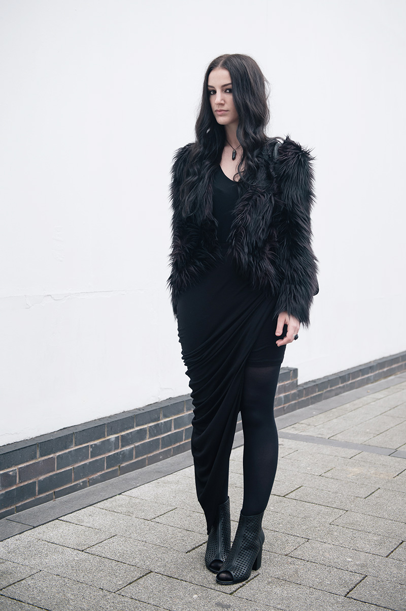 Fashion blogger Stephanie of FAIIINT wearing H&M faux fur shaggy jacket, Helmut Lang tee, FAIIINT clothing swathe draped skirt, Elemental Luxury Quartz Neclace & Ring, Ash Fancy BIS laser cut out leather boots, Mulberry Mabel bag. All black gothic winter street style outfit.