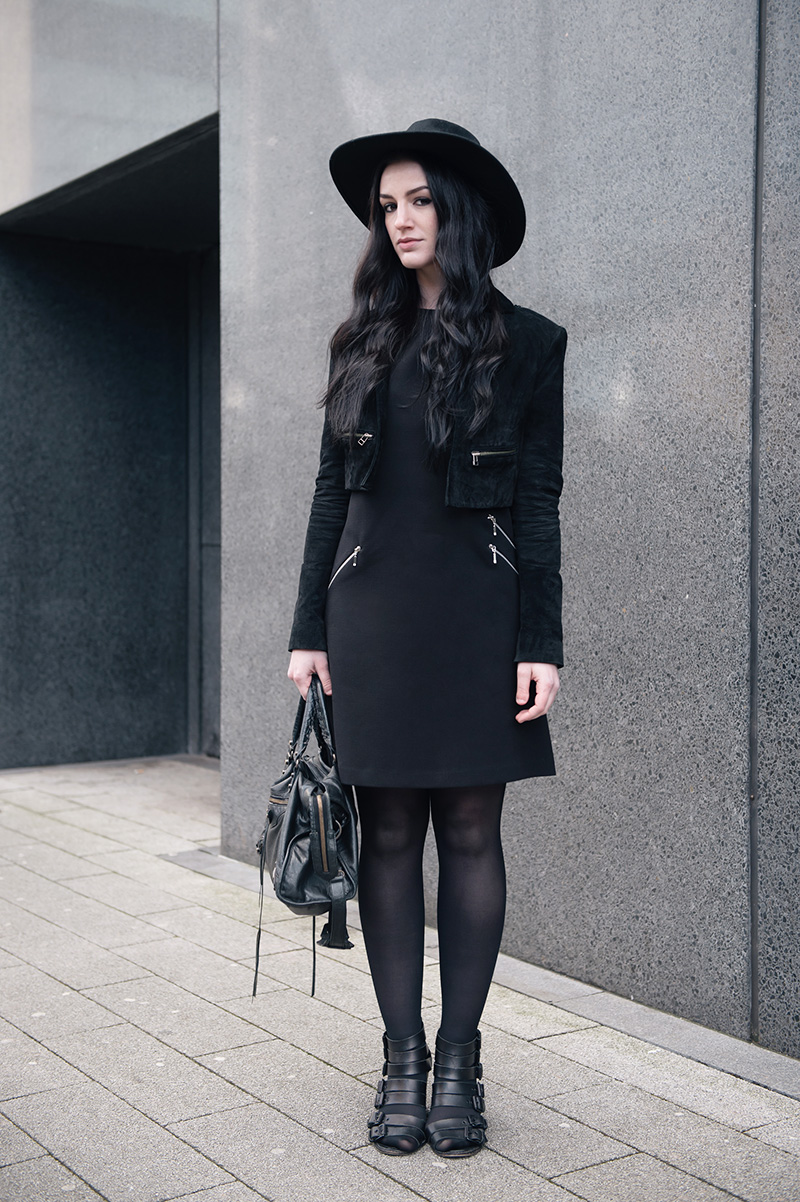 Fashion blogger Stephanie of FAIIINT wearing Catarzi Fedora, Topshop Cropped Suede Jacket, F&F at Tesco Zip Shift Dress, Kurt Geiger Buckled Wedges, Balenciaga City Bag. All black everything smart gothic street style.