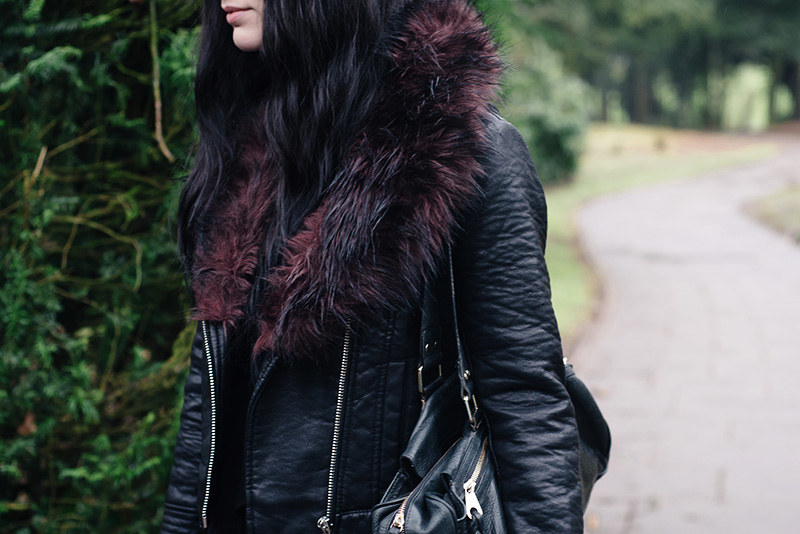 Fashion blogger Stephanie of FAIIINT wearing Warehouse faux leather jacket with burgundy fur trim. Outfit details.